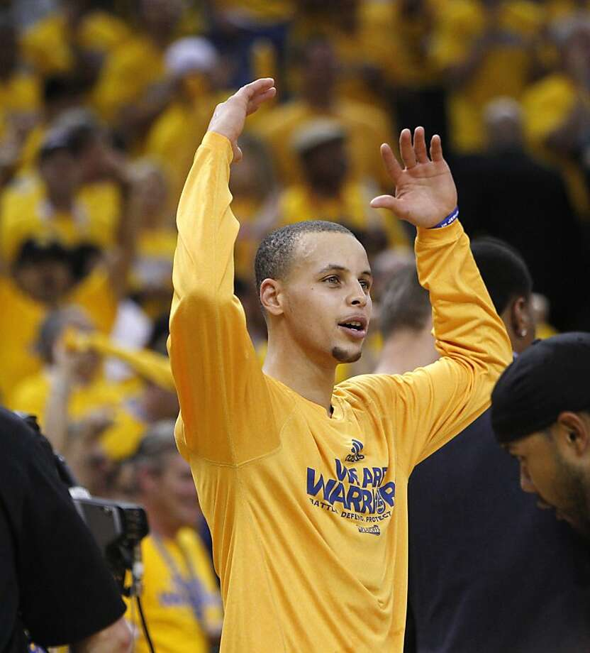 Stephen Curry (30) urges the fans on from the bench in the second half of the game on Thursday. The Golden State Warriors played the Denver Nuggets in Game 6 of the first round of the NBA playoffs at Oracle Arena in Oakland, Calif., on Thursday, May 2, 2013. Photo: Carlos Avila Gonzalez, The Chronicle