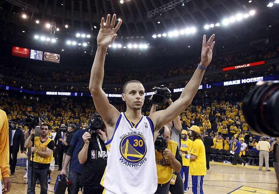 Stephen Curry raises his arms and acknowledges the fans after defeating the Nuggets and advancing to the next round of the playoffs on Thursday. The Golden State Warriors played the Denver Nuggets in Game 6 of the first round of the NBA playoffs at Oracle Arena in Oakland, Calif., on Thursday, May 2, 2013. Photo: Carlos Avila Gonzalez, The Chronicle