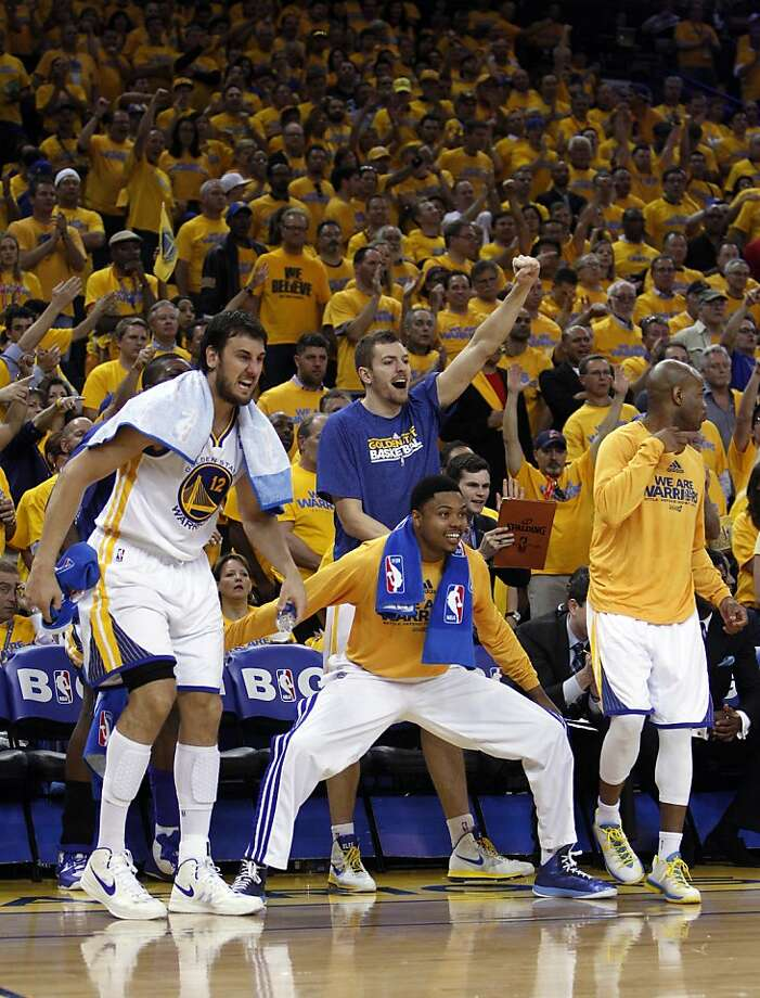 The Warriors bench reacts to a Warriors score in the second half of the game on Thursday. The Golden State Warriors played the Denver Nuggets in Game 6 of the first round of the NBA playoffs at Oracle Arena in Oakland, Calif., on Thursday, May 2, 2013. Photo: Carlos Avila Gonzalez, The Chronicle