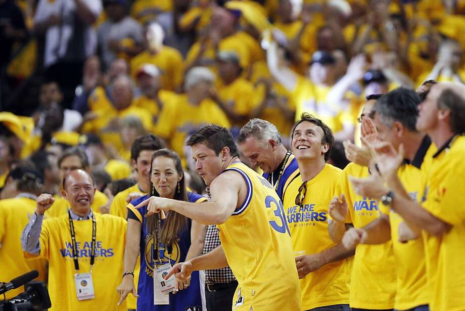 Warriors fans react to the team taking a 15-point lead in the second half of the game on Thursday. The Golden State Warriors played the Denver Nuggets in Game 6 of the first round of the NBA playoffs at Oracle Arena in Oakland, Calif., on Thursday, May 2, 2013. Photo: Carlos Avila Gonzalez, The Chronicle