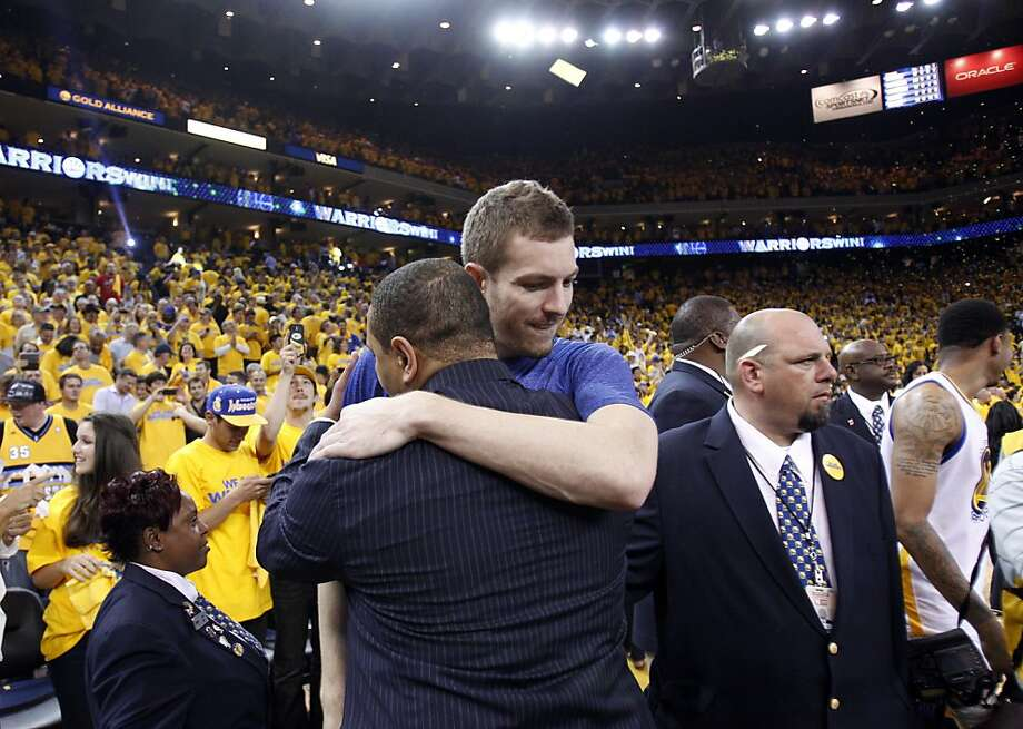 David Lee hugs head coach Mark Jackson after the Warriors defeated the Nuggets, advancing to the next round of the playoffs on Thursday. The Golden State Warriors played the Denver Nuggets in Game 6 of the first round of the NBA playoffs at Oracle Arena in Oakland, Calif., on Thursday, May 2, 2013. Photo: Carlos Avila Gonzalez, The Chronicle