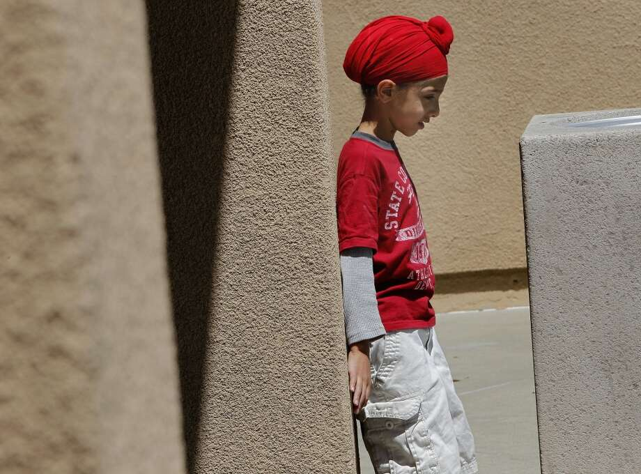 Six year old Arjun Bedi waits near his mother outside a grocery store in San Ramon, Calif. on Tues. April 30, 2013. The exploding influx of Asian immigrants into California in recent years has created a new phenomenon up and down the state, the Asian suburb.