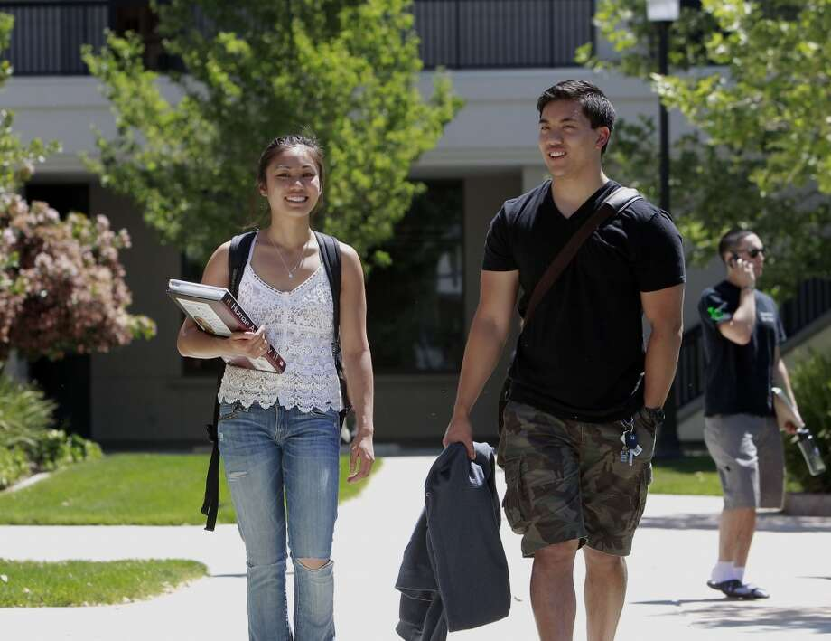 Diablo Valley College students, Alicia Bach, of San Ramon and Kyle Caspit, of Danville on the San Ramon, Calif. campus on Tues. April 30, 2013. The exploding influx of Asian immigrants into California in recent years has created a new phenomenon up and down the state, the Asian suburb.