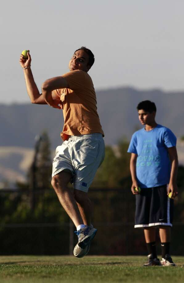 Cricket bowler Simran Bedi throws during a practice with the Titans, at Windemere Middle School in San Ramon, Calif. on Tues. April 30, 2013. The exploding influx of Asian immigrants into California in recent years has created a new phenomenon up and down the state, the Asian suburb.