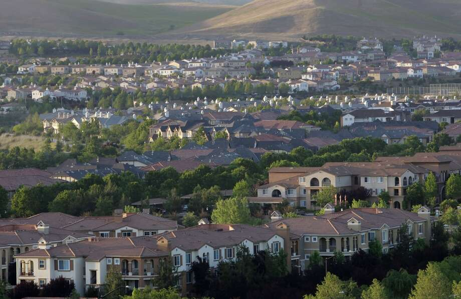 Houses cover the hills in San Ramon, Calif. on Tues. April 30, 2013, as the population continues to grow in the valley. The exploding influx of Asian immigrants into California in recent years has created a new phenomenon up and down the state, the Asian suburb.