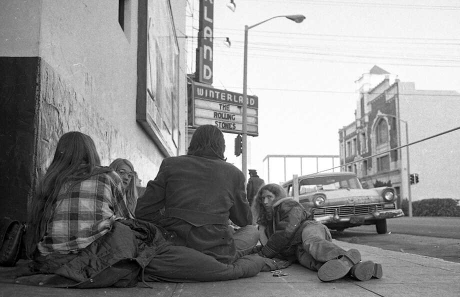 "June 13, 1972: Four of the coolest-looking Rolling Stones fans on the planet wait in front of the Winterland Ballroom in San Francisco, a month after the release of ""Exile on Main Street."" The Stones played four shows over two days -- selling out 20,000 tickets in about an hour."