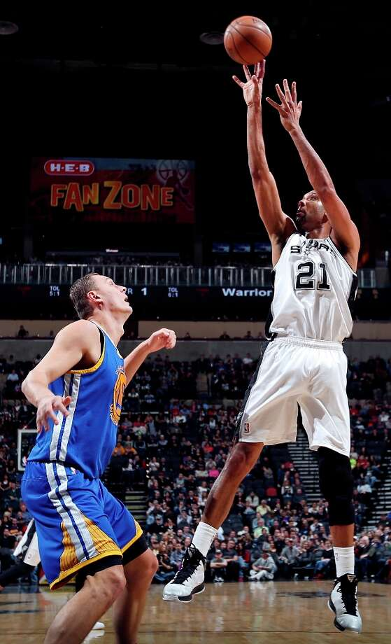The Spurs' Tim Duncan shoots over Golden State Warriors' Andris Biedrins during first half action Friday Jan. 18, 2013 at the AT&T Center. Photo: Edward A. Ornelas, San Antonio Express-News / © 2012 San Antonio Express-News