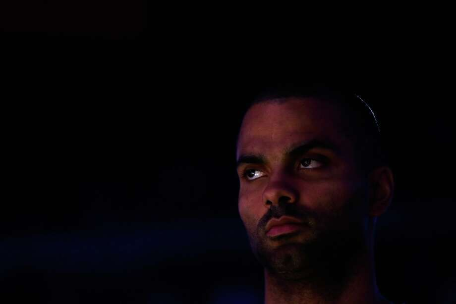 Tony Parker of the Spurs stands for the National Anthem before their game against the Warriors at Oracle Arena on Feb. 22, 2013 in Oakland, California. Photo: Ezra Shaw, Getty Images / 2013 Getty Images