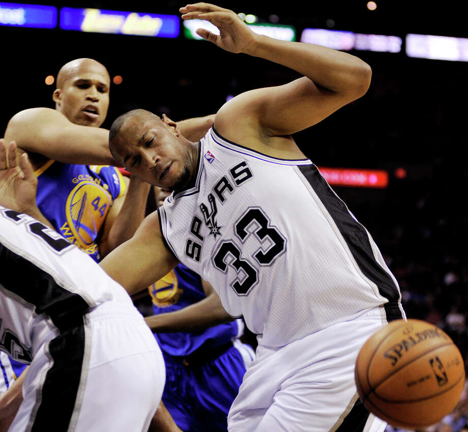 San Antonio Spurs' Boris Diaw (33), of France, chases a loose ball ahead of Golden State Warriors' Richard Jefferson during the first half of an NBA basketball game, Wednesday, March 20, 2013, in San Antonio. Photo: Darren Abate, Associated Press / FR115 AP