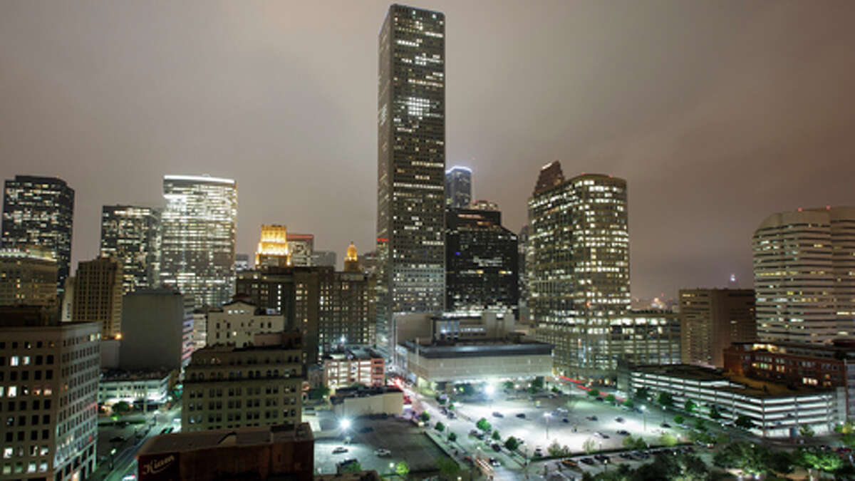 """Mayor Annise Parker sat down with Wall Street Journal reporter Matthew Kaminski to discuss how Houston went from a """"redneck white city down in Texas"""" to the bustling """"boomtown"""" it has become. The downtown Houston skyline seen from the penthouse suite of the Hotel Icon, April 15, 2013."""