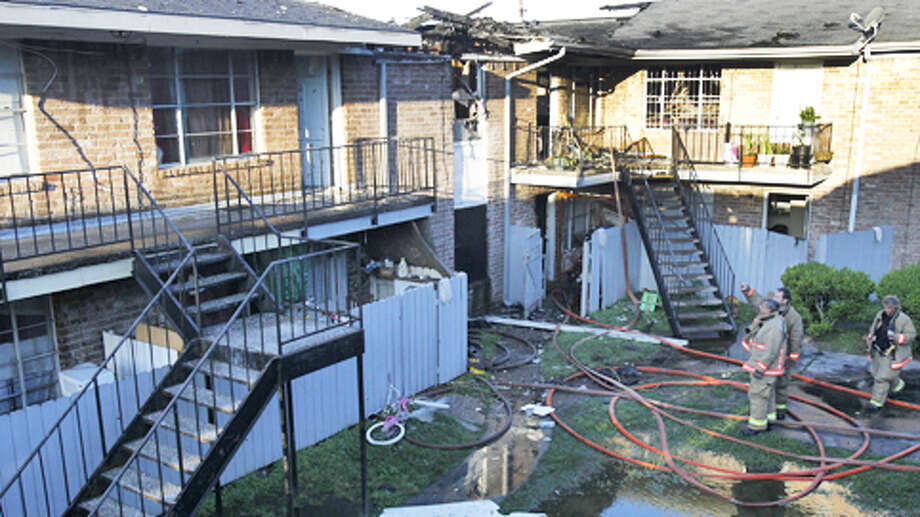 High winds hampered firefighters as a three-alarm blaze ripped through Fairmont apartments at 7303 Hillcroft in southwest Houston. The blaze broke out about 3:20 a.m. Photo: Cody Duty / Houston Chronicle