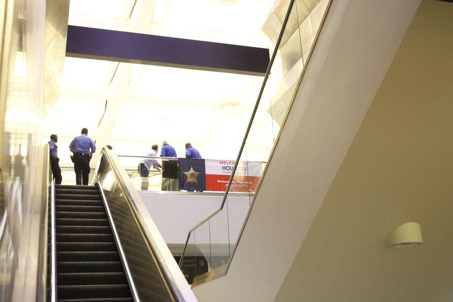 Security stands at the bottom of the escalators as police investigate a shooting in Terminal B at Bush Intercontinental Airport in Houston, Thursday, May 2, 2013.  Photo: Cody Duty