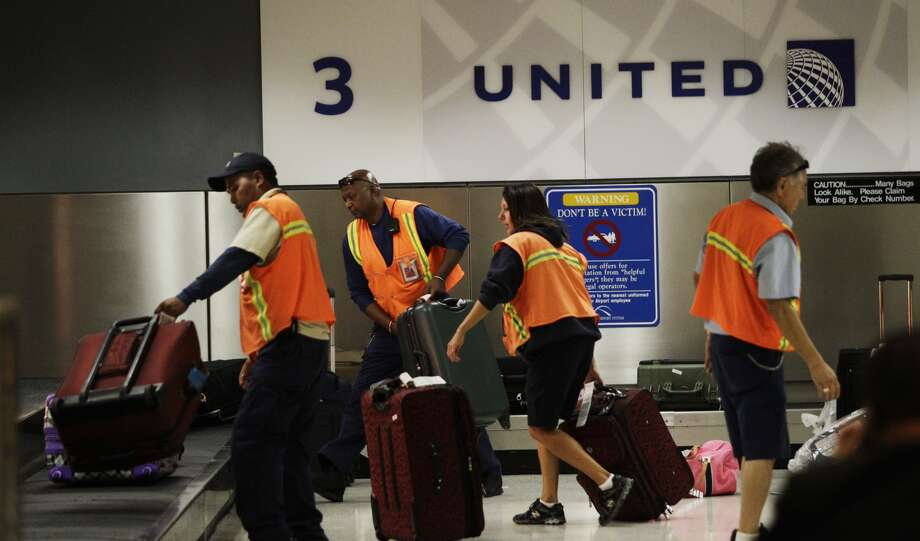 Luggage is reloaded onto conveyor belt to be taken to another area for passenger pickup after a shooting in Terminal B at Bush Intercontinental Airport, Thursday, May 2, 2013 Photo: Melissa Phillip