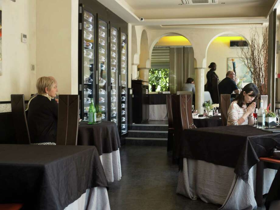 A general interior view of French chef David Faure's restaurant 'Aphrodite' in Nice on May 2, 2013 in Nice, France. Crickets and worms as produce for culinary requirements cost up to 1250 euros per kilogramme on May 2, 2013 in Nice, France. Faure's restaurant, renowned for it's innovative and inventive cuisine, has been awarded one star in the Michelin Guide. Photo: Didier Baverel, Getty / 2013 Didier Baverel