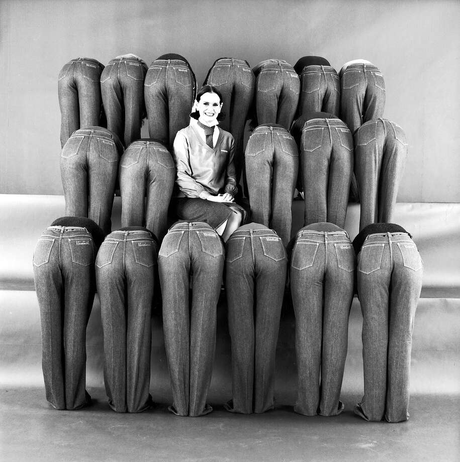 The behinds of 18 jean-clad female models bent over from the waist as they stand on three rows of risers while surrounding heiress Gloria Vanderbilt who is the backer of this topselling line of signature denims. Photo: Evelyn Floret, Time & Life Pictures/Getty Image / Evelyn Floret