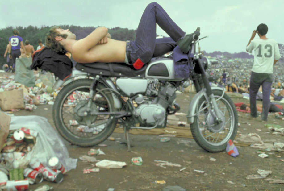 Shirtless man in Levi Strauss jeans lying on motorcycle seat at Woodstock music festival. Photo: Bill Eppridge, Time & Life Pictures/Getty Image / Time Life Pictures