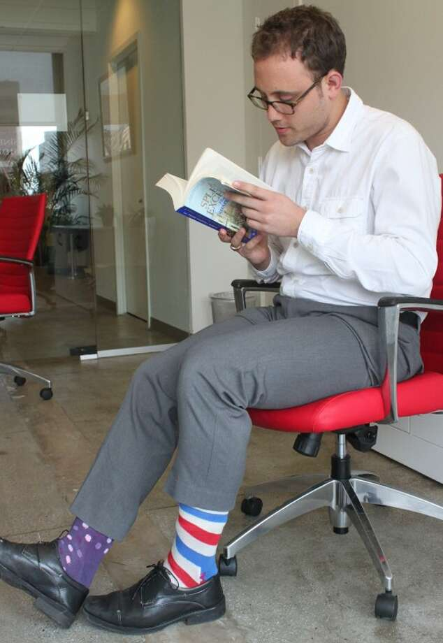 Bold socks are a new trend for men in the office. You can show off some style without be too bold.