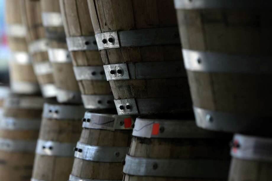 """Barrels of baby bourbon are stacked at Tuthilltown Spirits on Wednesday, April 17, 2013, in Gardiner, N.Y. Some call it """"grain to glass,"""" the booze equivalent of the local-food slogan """"farm to table,"""" though in the case of the apple vodka made from Hudson Valley at Tuthilltown, it's more like """"tree to tumbler."""" Whatever the name, it's catching on. Photo: Mike Groll, AP / AP"""