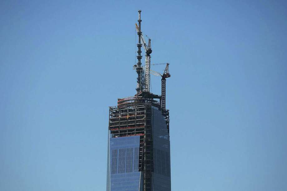 NEW YORK, NY - MAY 02:  The 408-foot spire is seen after it was hoisted onto a temporary platform on the top of One World Trade Center on May 2, 2013 in New York City. When bolted into place at a later date, the spire will make One World Trade Center the tallest building in the Western Hemisphere.The raising of the spire, which comes on the second anniversary of the death of Osama bin Laden, will make One World Trade Center 1,776 feet tall. One World Trade Center is built on the site where the September 11, 2001 attacks toppled the original World Trade Center towers. Photo: Spencer Platt, Getty Images / 2013 Getty Images