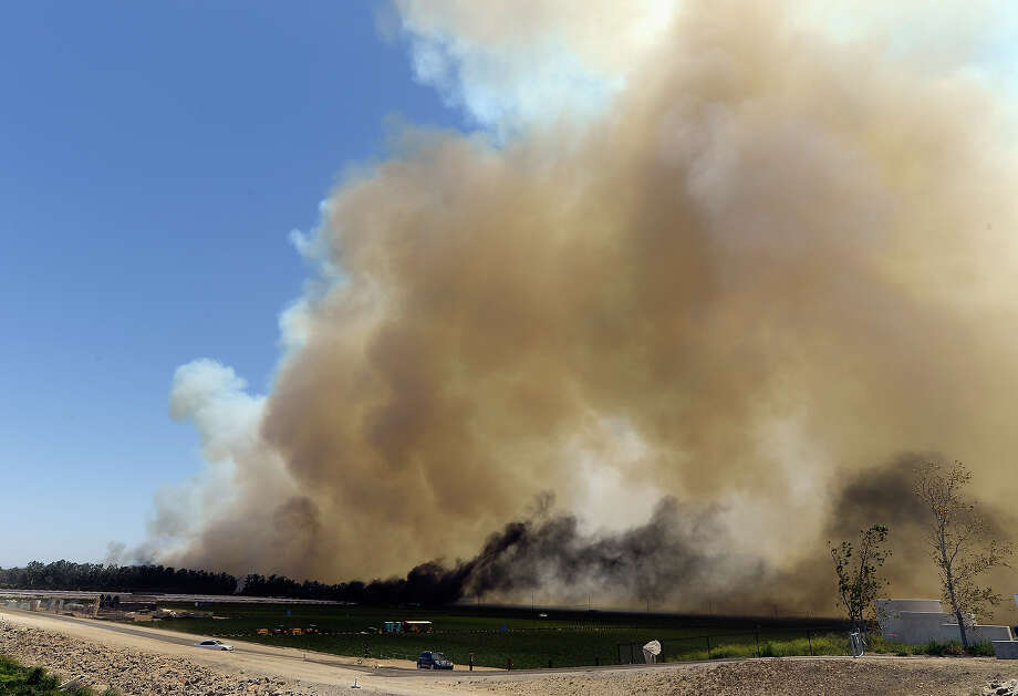 A strawberry farm catches on fire near the California State University Chanel Islands on May 2, 2013 in Camarillo, California. Hundreds of firefighters are battling wind and dry conditions as over 6000 acres have already been burned northwest of Los Angeles. Photo: Kevork Djansezian, Getty Images / 2013 Getty Images