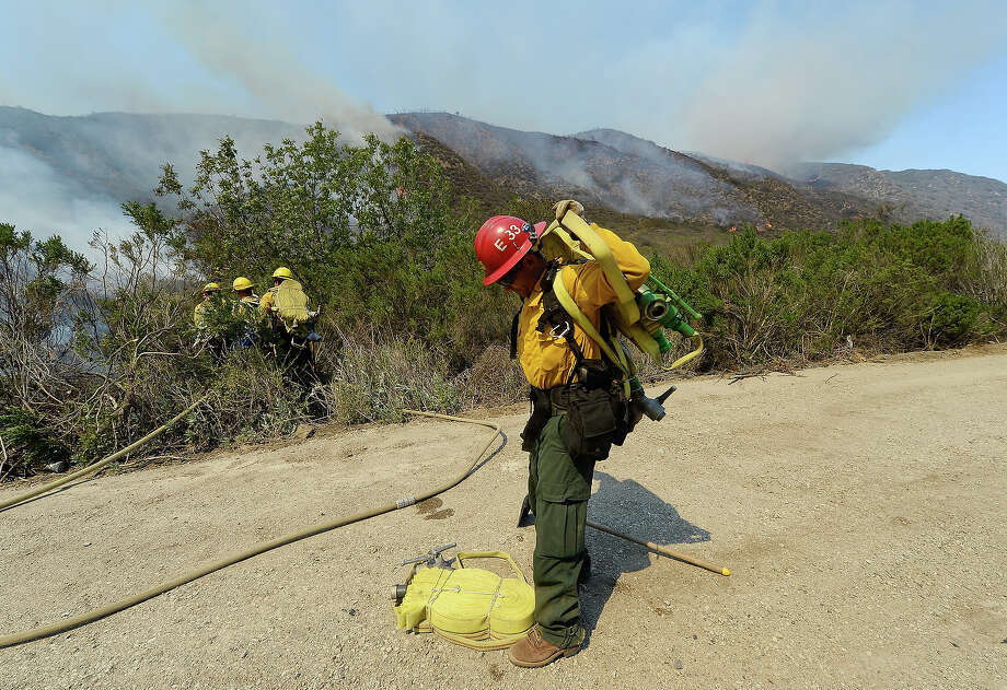 US Forestry fire fighters preapre to take on an out of control wildfire on May 2, 2013 in Camarillo, California. Hundreds of firefighters are battling wind and dry conditions as over 6000 acres have already been burned northwest of Los Angeles. Photo: Kevork Djansezian, Getty Images / 2013 Getty Images