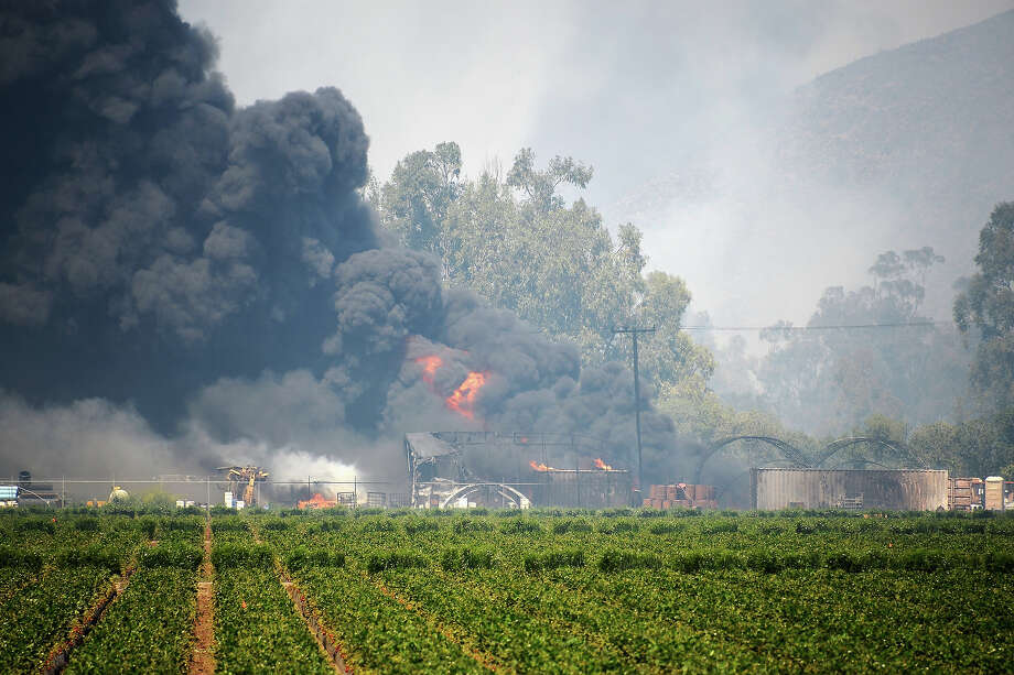 A chemical fire with pesticides and fertilizers continues to burn next to a strawberry farm during an out of control wildfire on May 2, 2013 in Camarillo, California. Hundreds of firefighters are battling wind and dry conditions as over 6000 acres have already been burned northwest of Los Angeles. Photo: Kevork Djansezian, Getty Images / 2013 Getty Images