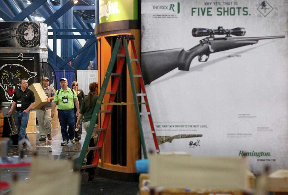 Exhibitors began setting up in preparation for the National Rifle Association's 142 Annual Meetings and Exhibits at the George R. Brown Convention Center Thursday, May 2, 2013, in Houston. 