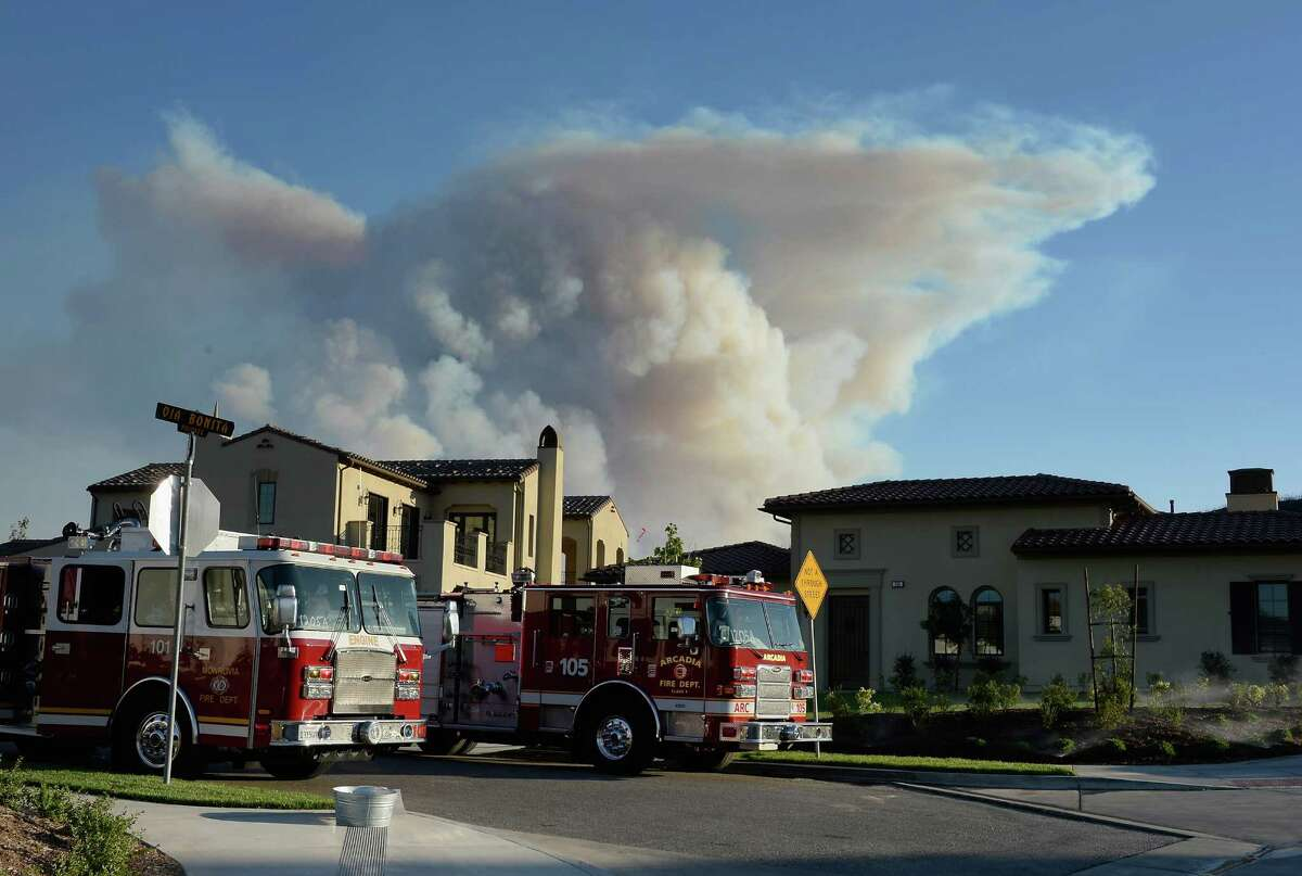 NEWBURY PARK, CA - MAY 02: A large plum of smoke rises from an out of control wildfire on May 2, 2013 in Newbury Park, California. Hundreds of firefighters are battling wind and dry conditions as over 6000 acres have already been burned northwest of Los Angeles.