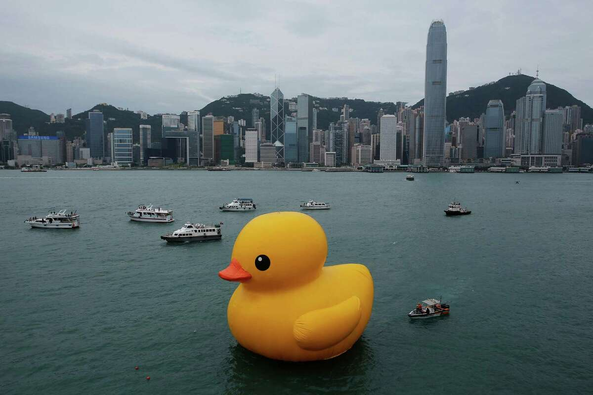 A giant Rubber Duck created by Dutch artist Florentijn Hofman is towed along Hong Kong's Victoria Habour Thursday, May 2, 2013. Since 2007 the 16.5-meter (54 feet)-tall Rubber Duck has traveled to various cites including Osaka, Sydney, Sao Paulo and Amsterdam.