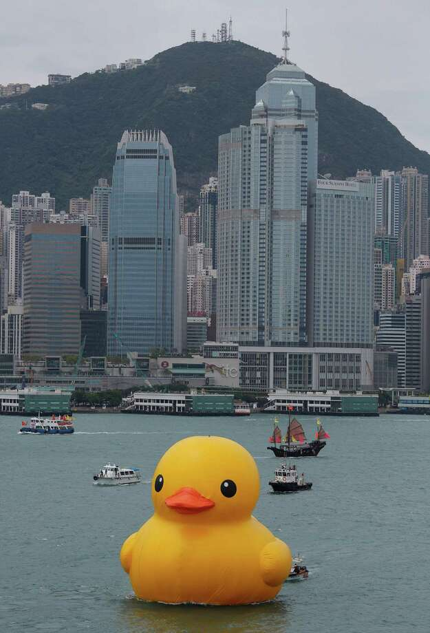 A giant Rubber Duck created by Dutch artist Florentijn Hofman is towed along Hong Kong's Victoria Habour Thursday, May 2, 2013. Since 2007 the 16.5-meter (54 feet)-tall Rubber Duck has traveled to various cites including Osaka, Sydney, Sao Paulo and Amsterdam. Photo: Vincent Yu, AP / AP