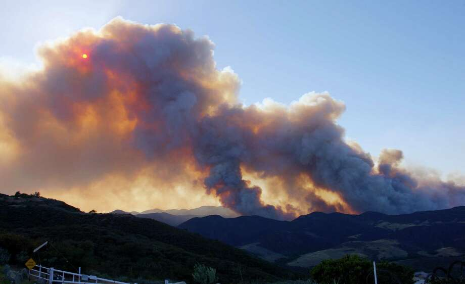 Smoke billows from a fire burring in Point Mugu State Park during a wildfire that burned several thousand acres, Thursday, May 2, 2013, in Ventura County, Calif. Photo: Mark J. Terrill, AP / AP