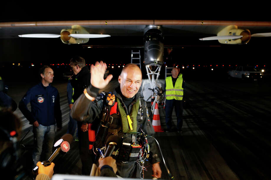 Pilot Bertrand Piccard  waves goodbye before taking off in the Solar Impulse solar electric airplane at Moffett Field on May 3, 2013 in Mountain View, California. Pilots Bertrand Piccard and Andre Borschberg are attempting the first cross-continental flight in a solar powered plane that can travel day and night. Photo: Beck Diefenbach, Getty Images / 2013 Getty Images