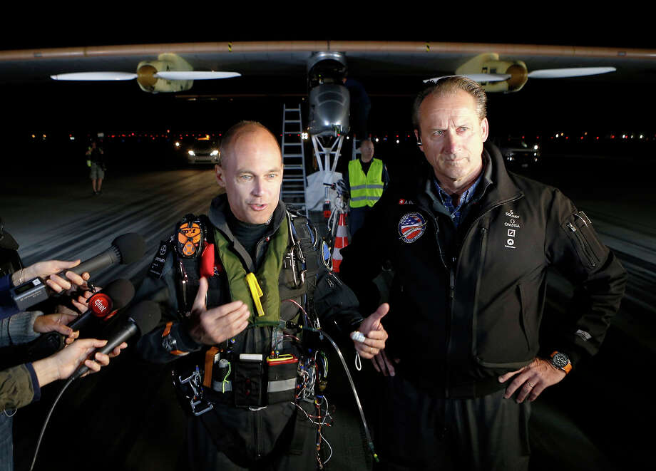 Pilots Bertrand Piccard (L) and Andre Borschberg answer questions before Piccard took off in the Solar Impulse solar electric airplane at Moffett Field on May 3, 2013 in Mountain View, California. Pilots Bertrand Piccard and Andre Borschberg are attempting the first cross-continental flight in a solar powered plane that can travel day and night. Photo: Beck Diefenbach, Getty Images / 2013 Getty Images