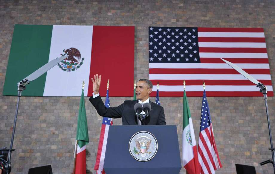 US President Barack Obama waves as he arrives on stage to speak at the National Anthropology Museum on May 3, 2013 in Mexico City. AFP PHOTO/Mandel NGANMANDEL NGAN/AFP/Getty Images Photo: MANDEL NGAN, AFP/Getty Images / AFP
