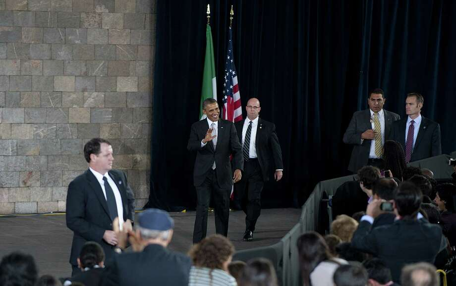 US President Barack Obama (C) arrives to deliver a speech during his meeting with Mexican young people at the Antrophology Museum in Mexico City on May 3, 2013.  AFP PHOTO/ Yuri CORTEZYURI CORTEZ/AFP/Getty Images Photo: YURI CORTEZ, AFP/Getty Images / AFP