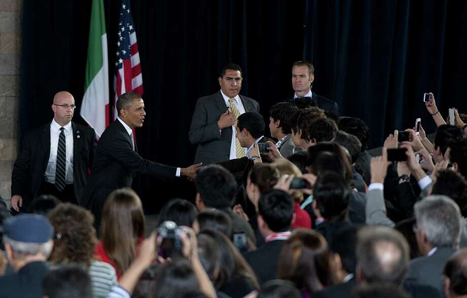 US President Barack Obama (2-L) arrives to deliver a speech with Mexican young people at the Antrophology Museum in Mexico City on May 3, 2013. Obama landed in Mexico on Thursday at the start of a three-day trip that will also take him to Costa Rica, with trade, US immigration reform and the drug war high on the agenda.   AFP PHOTO/ Yuri CORTEZYURI CORTEZ/AFP/Getty Images Photo: YURI CORTEZ, AFP/Getty Images / AFP
