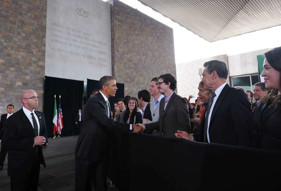 US President Barack Obama greets guests as to speak at the National Anthropology Museum on May 3, 2013 in Mexico City. Obama landed in Mexico on Thursday at the start of a three-day trip that will also take him to Costa Rica, with trade, US immigration reform and the drug war high on the agenda.  AFP PHOTO/Mandel NGANMANDEL NGAN/AFP/Getty Images Photo: MANDEL NGAN, AFP/Getty Images / AFP