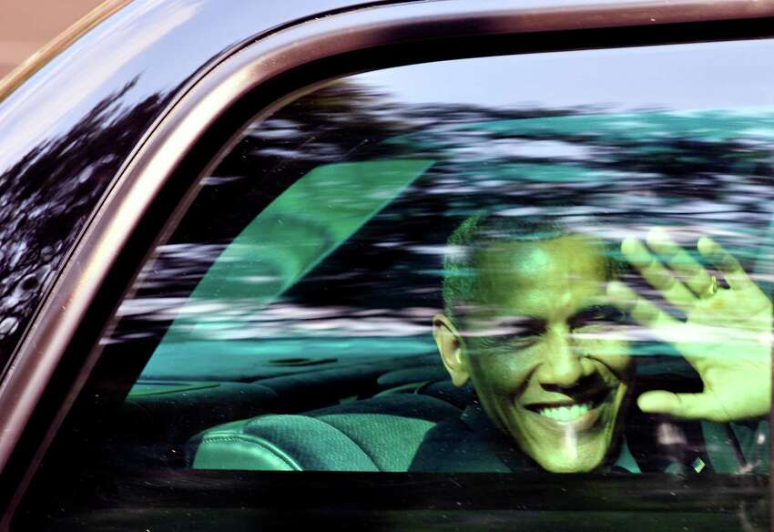 TOPSHOTS US President Barack Obama waves through the window of his car in Mexico City, on May 2, 2013. Obama landed in Mexico on Thursday at the start of a three-day trip that will also take him to Costa Rica, with trade, US immigration reform and the drug war high on the agenda. AFP PHOTO/Hector GuerreroHECTOR GUERRERO/AFP/Getty Images