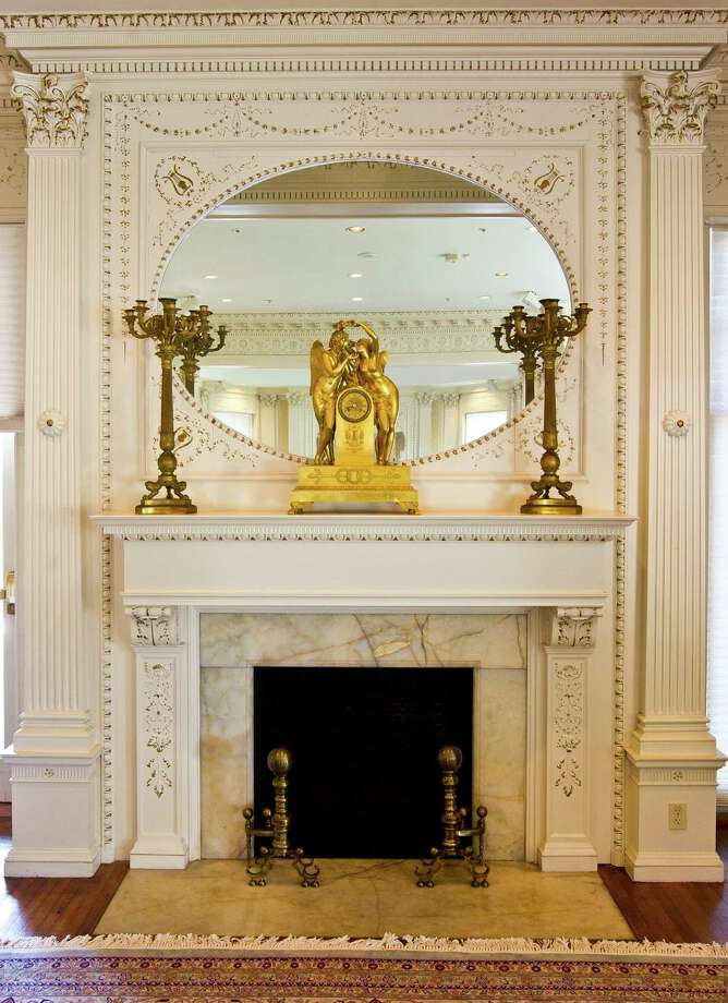 One of two fire places in the Golden Room of the Open Gates historic mansion. Photo: Nick De La Torre, Staff / © 2013 Houston Chronicle