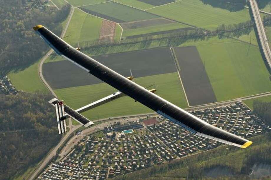 The Solar Impulse flies over Switzerland in 2011. Photo: Jean Revillard, Solar Impulse