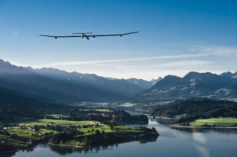 The Solar Impulse flies over mountains in Switzerland in 2010. Photo: Jean Revillard, Solar Impulse