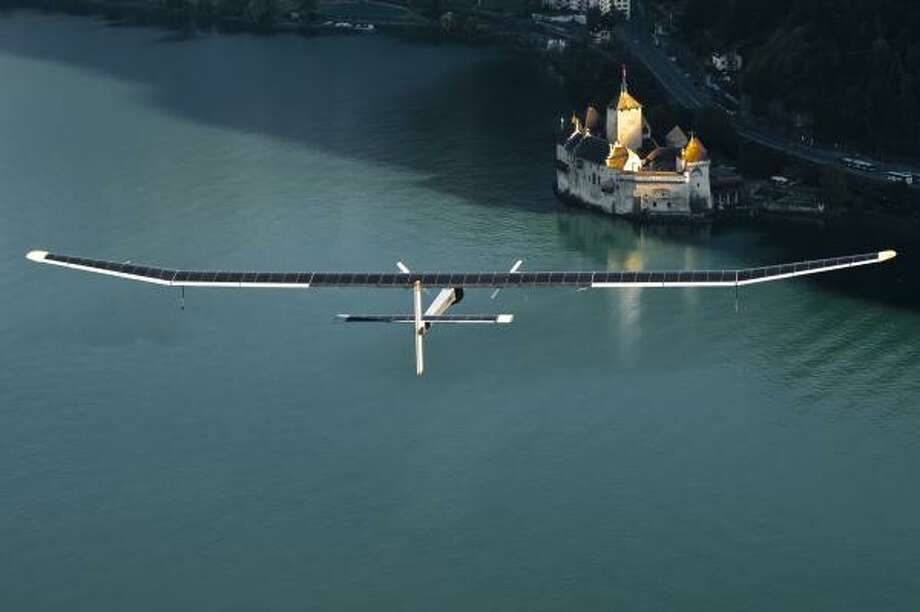The Solar Impulse flies over mountains in Switzerland in 2010. Photo: Jean Revillard, Solar Impulse