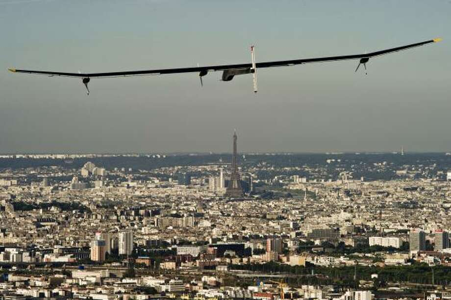 The Solar Impulse flies near the Eiffel Tower in Paris in 2011. Photo: Jean Revillard, Solar Impulse