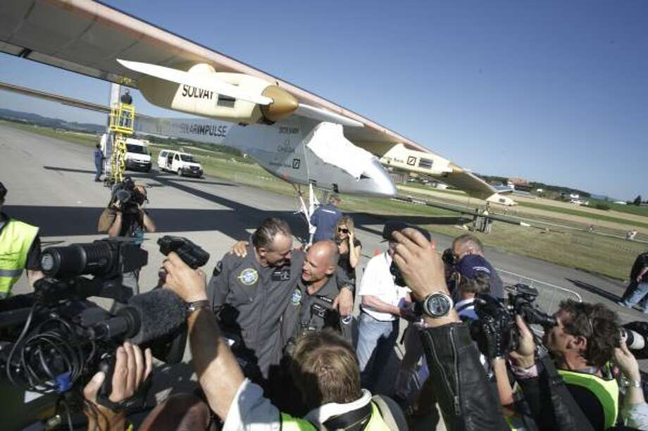Pilot Andre Borschberg is welcomed back on the ground after a successful 26-hour non-stop flight over Switzerland in July 2010. Photo: Solar Impulse