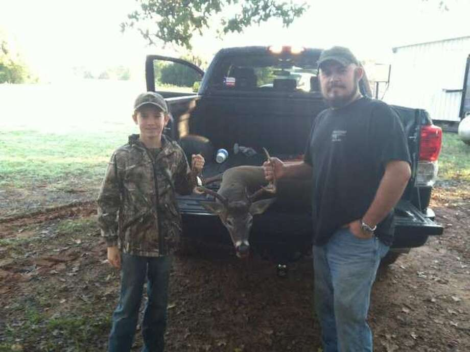 Travis Marett shot his first Buck in Franklin, Texas, on Nov. 3, 2012 with his father Joel Marett.  It was a nice 8 point. Photo: Reader Photo