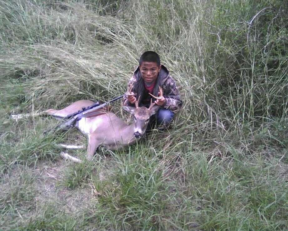 Eric Ray Tijerina, 10, with his first deer in Calhoun County in October 2012. Photo: Reader Photo
