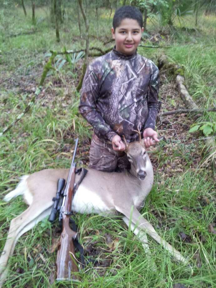 Eric Esparza, 13, shot his first deer on Oct. 27, 2012 on public land. Submitted by Ramon Esparza. Photo: Reader Photo