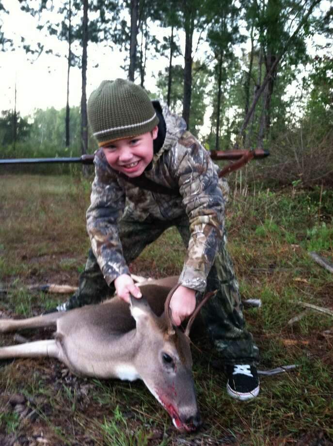 Alex Rodriguez was 8 year old in the fall of 2012 when he shot his first deer outside Jasper. Photo: Reader Photo