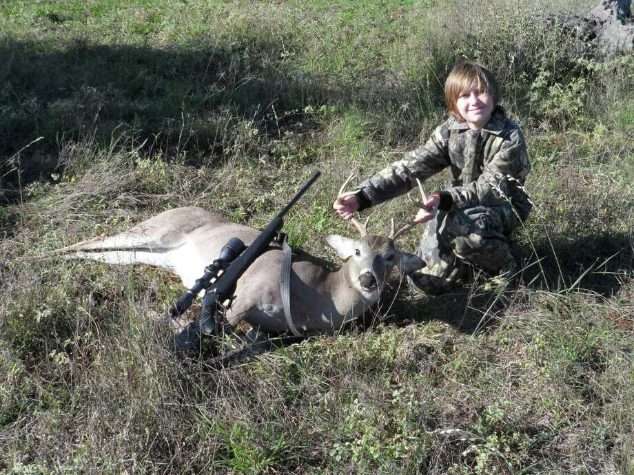 Trey Graves of Houston with his first deer at the age of 12. It's a 123-pound, 9-point. Submitted by Druann Graves. Photo: Reader Photo / COPYRIGHT, 2010