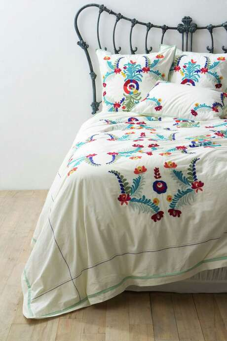 Slide a down comforter inside a duvet cover. Photo: Courtesy Anthropologie